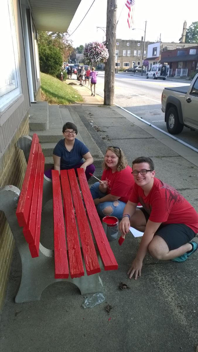 CHS students help paint benches in downtown Mantua